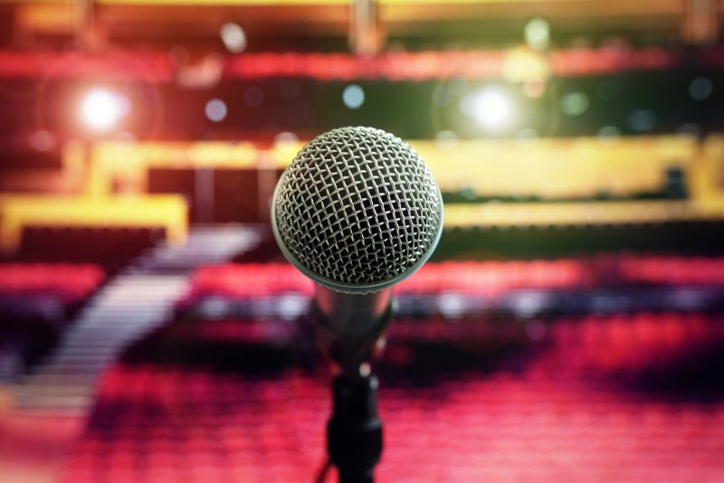 Superfly-microphone-on-stage-in-concert-hall-theater-PQ3Y669-1600